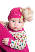Adorable baby girl with flower — Stock Photo