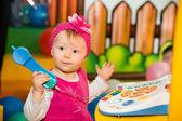 Happy child girl on playground — Stock Photo