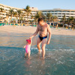 Stock Photo: Happy family: dad and child on beach