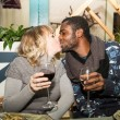 Kissing happy couple — Stock Photo