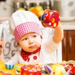 Baby cook girl wearing chef hat — Stock Photo