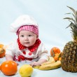 Baby girl with fresh fruits — Stock Photo