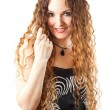 Stock Photo: Womwith curly long hair