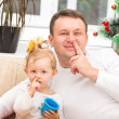 Stock Photo: Father and child girl picking his nose