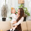 Stock Photo: Mom and child girl at home