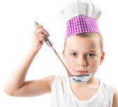 Boy cook  wearing chef hat with fresh vegetables and fruits — Stock Photo