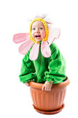 Adorable baby girl dressed in flower costume on white background — Stock Photo