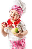 Baby cook girl wearing chef hat with fresh vegetables and fruits — Stock Photo