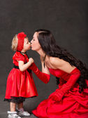 Happy mom and child girl and kissing — Stock Photo