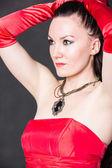 Beautiful woman in red satin dress — 图库照片