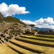 Panorama of Mysterious city - Machu Picchu, Peru,South America. The Incan ruins. Example of polygonal masonry and skill — Stock Photo #46418811