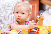 Portrait of child girl on kitchen — Stock Photo