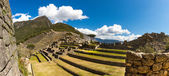 Panorama of Mysterious city - Machu Picchu, Peru,South America. The Incan ruins. Example of polygonal masonry and skill — Stock Photo