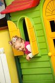 Little child girl playing in kindergarten in Montessori preschool Class. — Stock Photo