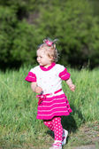 Girl runs on grass on meadow — Stock Photo