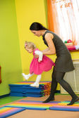 Mother and child girl playing in kindergarten — Stock Photo