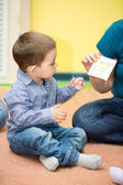 Little child boy playing in kindergarten — Stock Photo