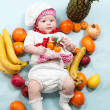 Baby girl with fruits. — Stock Photo #48256835