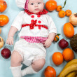Baby girl with fruits. — Stock Photo #48256883