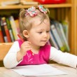 Child girl drawing with colorful pencils in preschool at the table. Little girl and boy drawing in kindergarten — Stock Photo