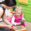 Mother and child girl playing in kindergarten in Montessori preschool Class. — Stock Photo #48256991