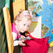 Little child girl playing in kindergarten in Montessori preschool Class. — Stock Photo #48257033