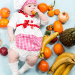 Baby girl with fruits. — Stock Photo #48257153