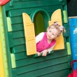 Little child girl playing in kindergarten in Montessori preschool Class. — Stock Photo #48257285