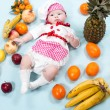 Baby girl with fruits. — Stock Photo #48257357