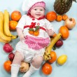 Baby girl with fruits. — Stock Photo #48257519