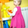 Little child girl playing in kindergarten in Montessori preschool Class. — Stock Photo #48257733