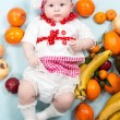 Baby girl with fruits. — Stock Photo #48257807