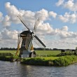 Landscape with a mill in The Netherlands — Stock Photo
