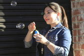 Woman with soap bubbles — Stockfoto