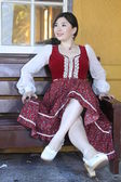 Vintage style barmaid sitting on bench — Photo