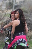 Two beautiful brunette biker girls on the bike — Foto Stock