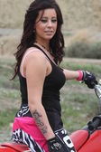 Beautiful brunette biker girl on the bike — Foto Stock
