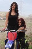 Two young biker women posing for the camera — Stock Photo