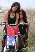 Two young biker women posing for the camera — Stock Photo
