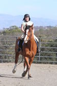 Asian woman on horseback — Stock Photo