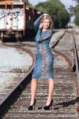 Photo shoot of a model at a railway yard — Стоковое фото