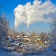 Smoking chimneys and village houses in winter — Stock Photo