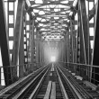Bridge and rails in the fog - Stock Photo