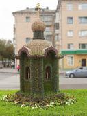 Church made of a green grass — Stock Photo