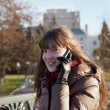A young girl on the phone — Stock Photo