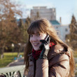 Stock Photo: A young girl on the phone