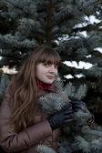 Beautiful girl with dark hair, wearing a brown coat — Stock Photo
