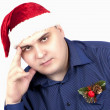 Stock Photo: Young min blue shirt and in cap of SantClaus