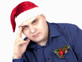 Young man in a blue shirt and in a cap of Santa Claus — Stock Photo