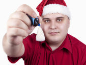 Young man in a red shirt and hat of Santa Claus — Stock Photo